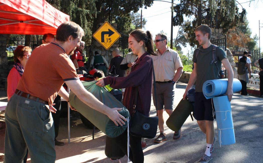 La Salle High School students Lauren Chacon and Patrick Madden drop off some sleeping bags and sleeping pads before hiking to Echo Mountain. The teens heard about the drive through their school's hiking club.