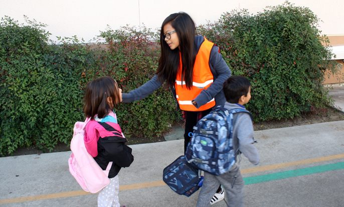 Photo by Merin McDonald / OUTLOOK Carver Elementary School 5th-grader Erica De los Santos, a member of the school's K-Patrol, directs kindergartners to their classrooms Friday morning.