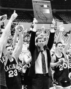 Coach Tom Hofman (center), flanked by guards Brent Ballard and Ryan Asplund, celebrate the Spartans' first CIF-SS basketball championship at the L.A. Sports Arena on March 7, 1992.