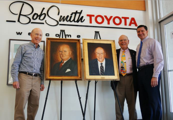 OUTLOOK photo The portraits of R.A. Smith and Bob Smith stand between Tim Smith (left) and Mike and Pete J. Smith, the latter two of whom run Bob Smith Toyota in La Crescenta.
