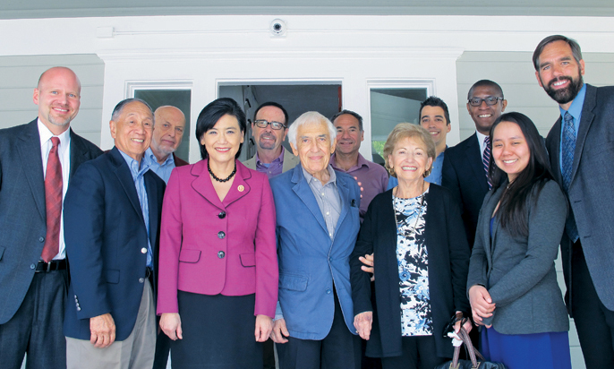 Door of Hope will celebrate 30 years of helping Pasadena homeless families rebuild their lives at a gala on Feb. 20. Pictured are Door of Hope board members, supporters and staff, including (front row, from left) Jim Howe, Bob Joe, Congresswoman Judy Chu, Door of Hope founders Steve and Iris Lazarian, and Door of Hope Executive Director Tim Peters (far right). Back: George Rothwell, Greg Waybright, Gil Gazanian and Jeremy Rose.