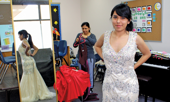 "Photo by Merin McDonald / OUTLOOK Monica Flores found a gown fit for a princess at the Salvation Army's recent Prom Dress Giveaway. The annual event gives high school seniors from low-income families the opportunity to ""shop"" for a free prom dress from an array of lightly used and brand-new donated frocks."