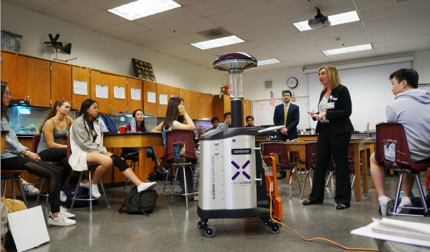 Photo by Mirjam Swanson / OUTLOOK La Cañada High School graduate Mary Virgallito, director of Patient Safety at USC Verdugo Hills Hospital, visited Mark Ewoldsen's AP biology class to introduce students to a Xenex germ-zapping robot.