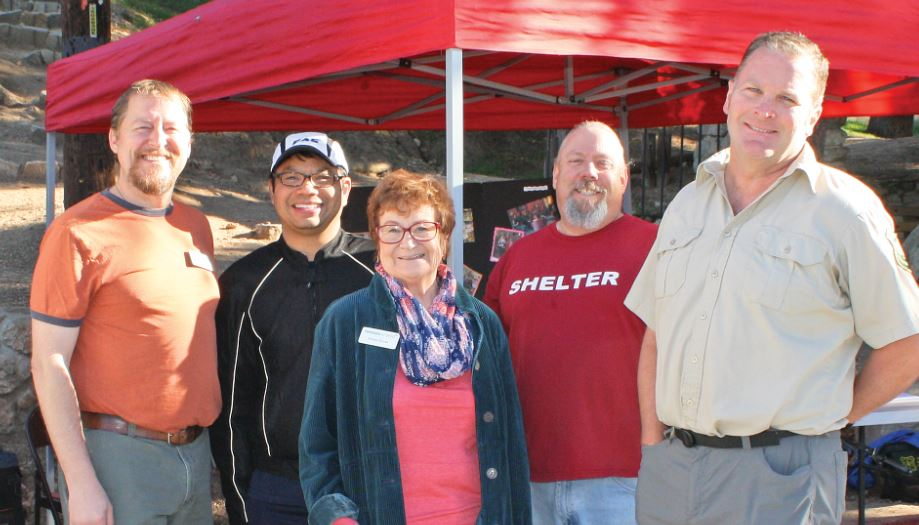 "Photo by Merin McDonald / OUTLOOK Friends in Deed Food Pantry Manager Tim Nistler, Board President Richard Cheung, Executive Director the Rev. Donna Byrns, Bad Weather Shelter Director William Shelby and Mike Simms of Friends of Echo Mountain hosted ""Hike for the Homeless"" at Altadena's Cobb Estate trailhead on Sunday. The event called on local hikers to donate used outdoor clothing and gear to aid those sleeping outdoors this winter."