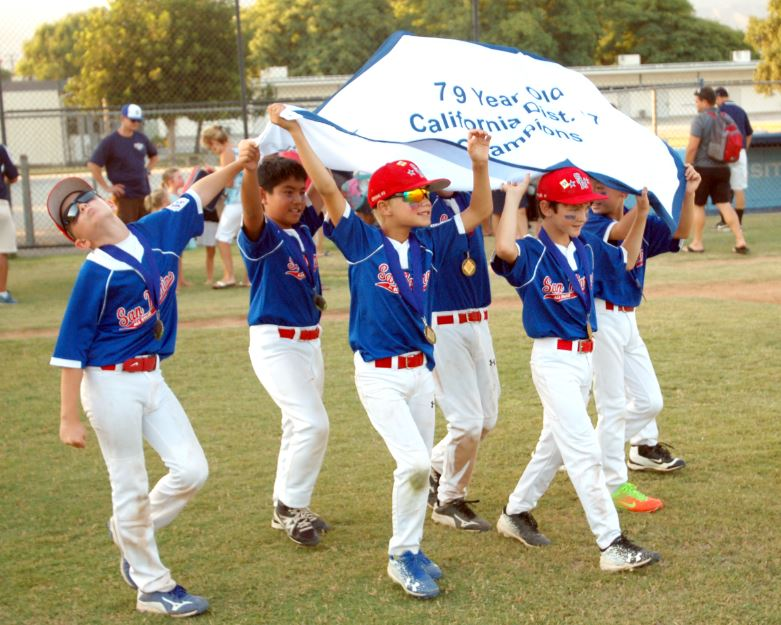Photo by Oscar Areliz / OUTLOOK Members of the San Marino National Little League 7-9 All-Star baseball team celebrate their 8-5 victory over Pasadena American Little League on Monday. The squad is the first to ever win the District 17 title in their division.