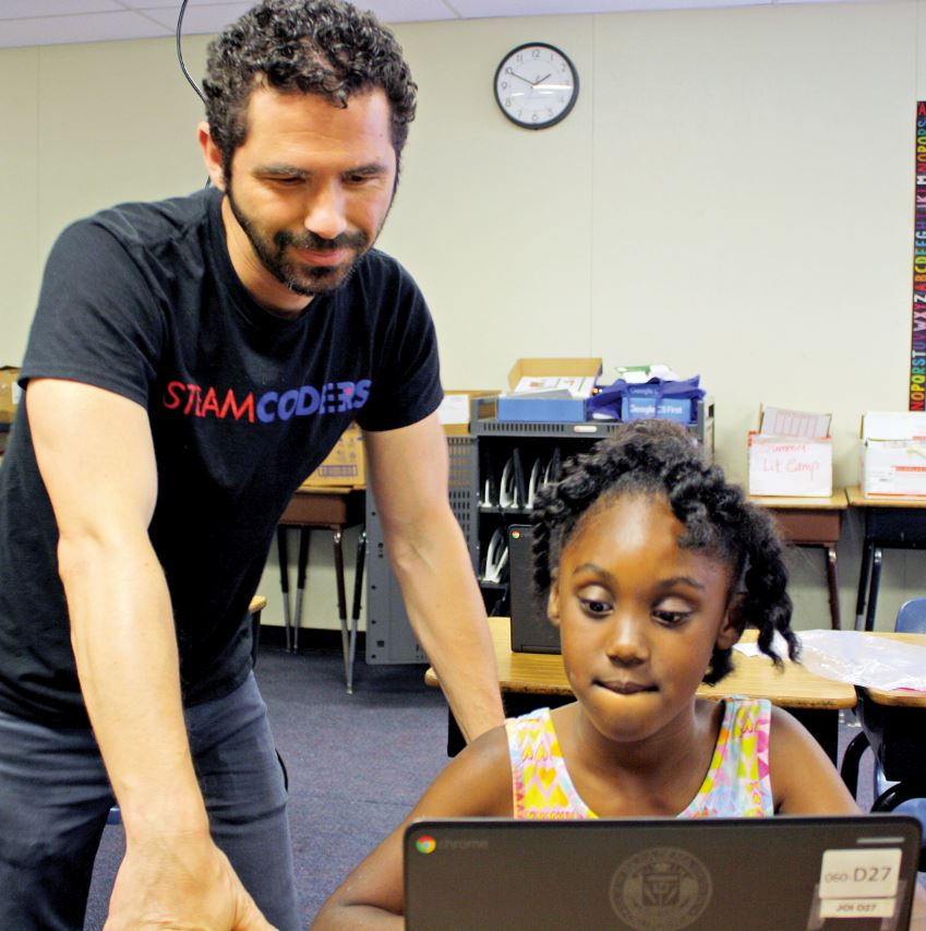 OUTLOOK photo Camper Genesis Montgomery gets help from instructor Michael Dragomir.