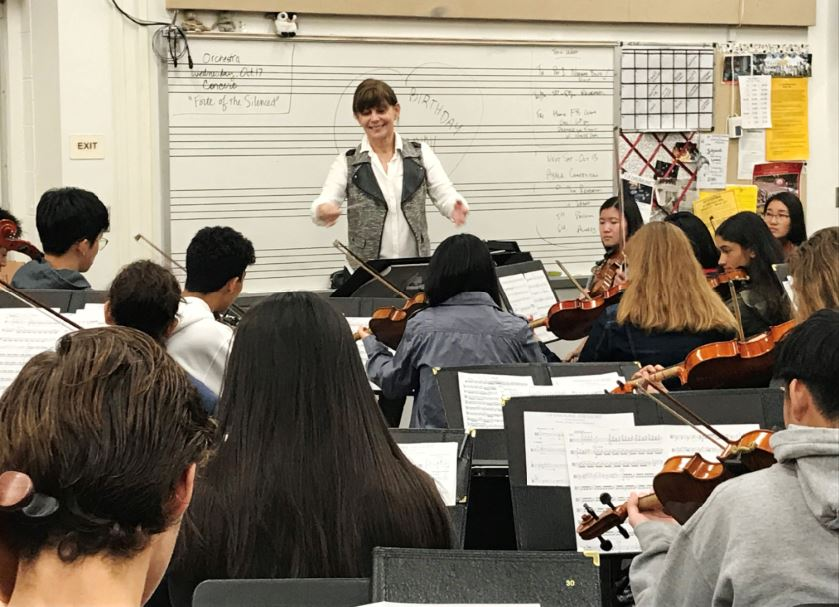 "Photo by Wes Woods II / OUTLOOK Jennifer Munday, La Cañada High School advanced orchestra director, instructs her musicians as they perform Yoko Shimomura's ""Kingdom Hearts."" They're preparing for a concert on Oct. 17."