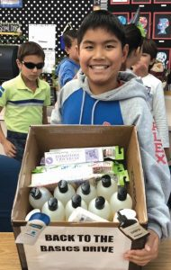 Photo courtesy Annie Chui Carver Student Council President Alex Chui shows off a donation of personal essentials from Trader Joe's.