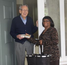 Photo courtesy Meals on Wheels A volunteer delivers a hot meal to a client.