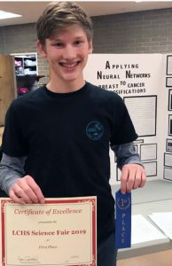"Photo by Wes Woods II / OUTLOOK LCHS student Jonah Garland, 16, won first place in the La Cañada High School Science Fair on Feb. 8 for his project ""Applying Neural Networks to Breast Cancer Classifications."""