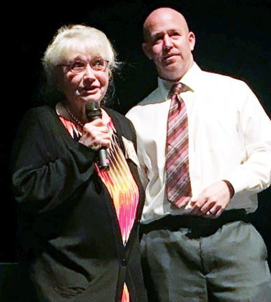 Holocaust survivor Trudie Strobel and La Cañada High School 7/8 Principal Jarrett Gold speak to the audience consisting mostly of 7th-graders.