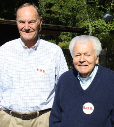 "Former LCFEF Presidents Neal Brockmeyer (1978-79) and Sid Karsh (1982-85) wear their original ""S.O.S."" buttons, the acronym for Save Our Schools, which was the organization's original name before being changed to LCFEF."