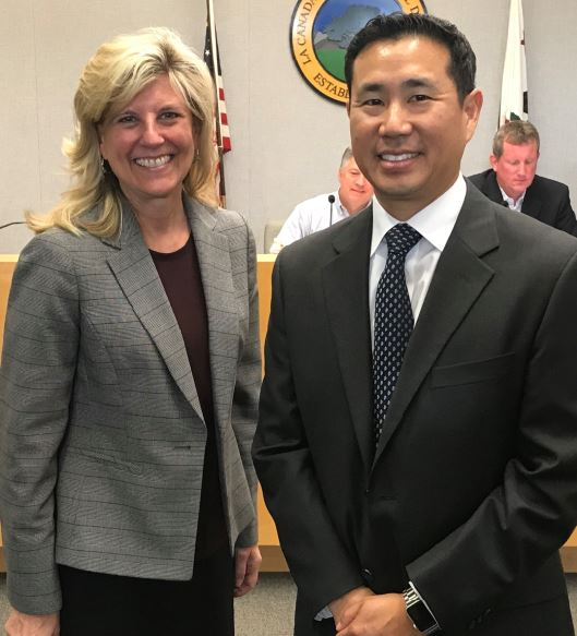 Photo by Wes Woods II / OUTLOOK La Cañada Unified School District Superintendent Wendy Sinnette shares a smile with Derek Ihori, newly named executive director of special education and psychological services, at a May 2 special LCUSD Governing Board meeting.