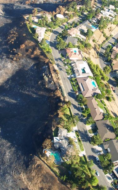 An aerial photo shows a stark contrast in the wake of the Station Fire — charred hillsides alongside the verdant neighborhood of Starlight Crest Drive in LCF. It also reveals the important job that firefighters did to prevent the loss of property. The aerial photo was made possible through a helicopter ride with Larry Welk of what is now Welk Aviation.