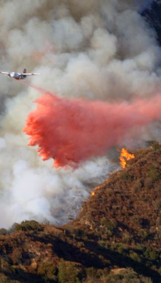 A tanker drops fire retardant on a slope near Starlight Crest Drive. The Station Fire burned more than 160,000 acres.