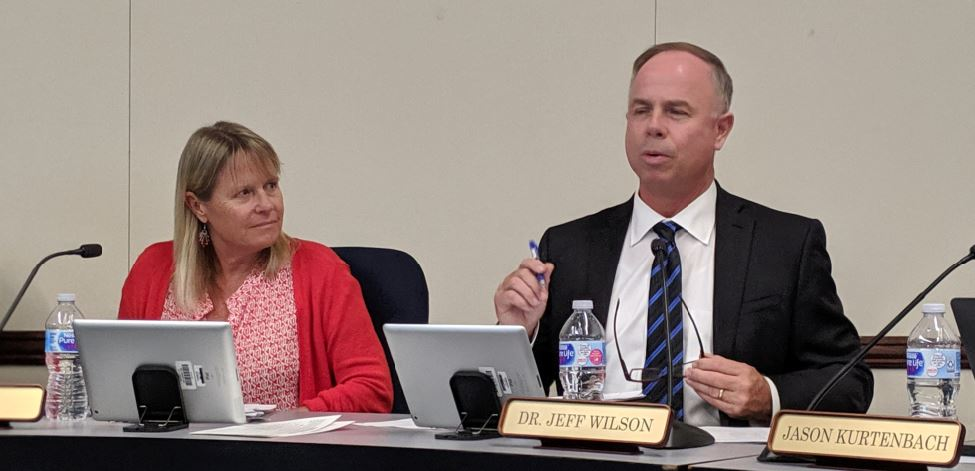 Superintendent Jeff Wilson speaks at a recent school board meeting as the panel's president, Lisa Link, listens. Wilson is forming a task force to analyze fiscal options and strategies for the cash-strapped local school district.