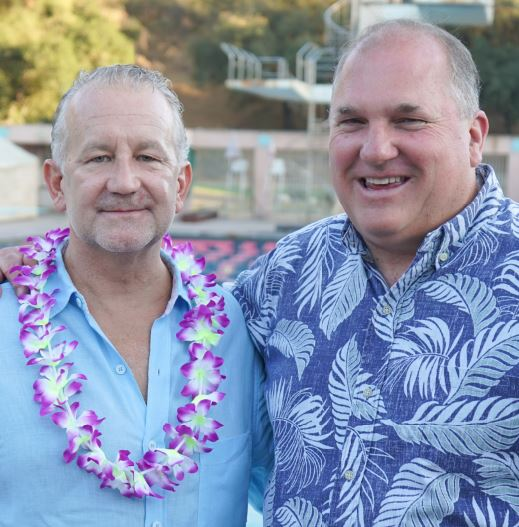 Rose Bowl Aquatics Center board chair Patrick Amsbry and Executive Director Kurt Knop are shown at the nonprofit's 2018 fundraiser luau event.