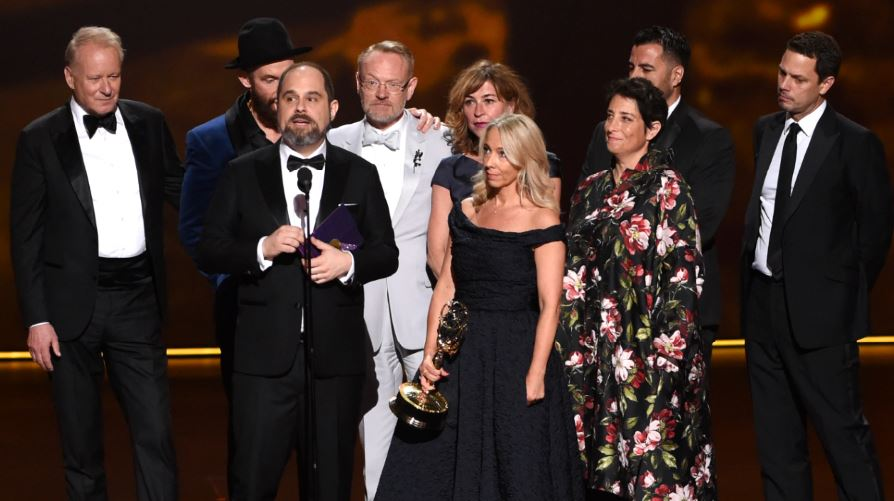 "The team from ""Chernobyl,"" including La Cañada Flintridge resident Craig Mazin (at microphone), accepts the award for outstanding limited series or movie at the Emmy Awards on Sunday at the Microsoft Theater in Los Angeles."