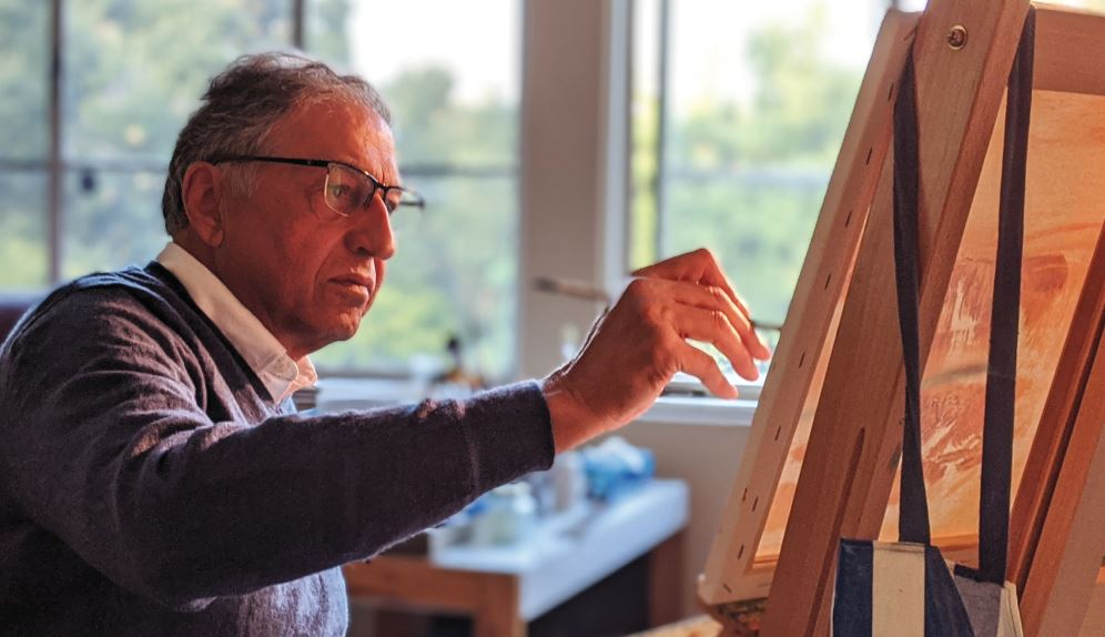 Photo by Zane Hill / OUTLOOK Dr. Robert Ghatan, a retired orthopedic surgeon, works on a landscape painting at his San Marino home, a hobby he now has ample time to explore.